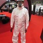 mannequin-man performming as a Living Mannequin: Wearing a 3M coverall with helmet and respirator