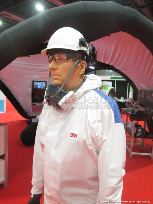 Wearing a 3M coverall with helmet and respirator