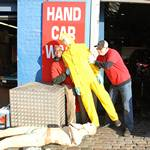 mannequin-man performming as a Mechanical Mannequin: Two employees from the American Car Wash Company replace the old mechanical waving dummy with the new model from mannequin man for American Car Wash on 22/10/2011