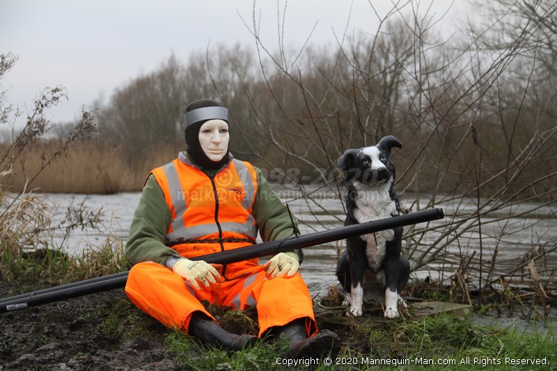 Mannequin man taking the place of one of the many mannequins used by the Angling Trust to humanely combat the problem of Cormorants devastating fishing stocks by providing a simulated human presence - Angling Trust Cormorant Scaring Mannequin Hampshire Avon