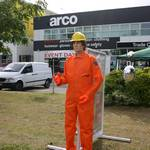 Automated mannequin mechanically waving to traffic at a promotional day for Arco in their shop in Orpington