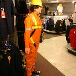 mannequin-man performming as a Living Mannequin: mannequin man waiting for a customer to try the timed put the safety harness on the dummy competition at Arco's Watford Event Day 2008 for Arco on 12/06/2008