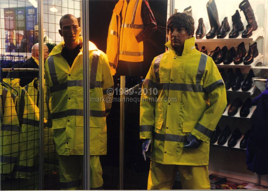 mannequin man at the Arco experience alexandra palace 1997, wearing an orange boilersuit and hi-viz jacket - Living Mannequin Arco Experience Alexandra Palace, London
