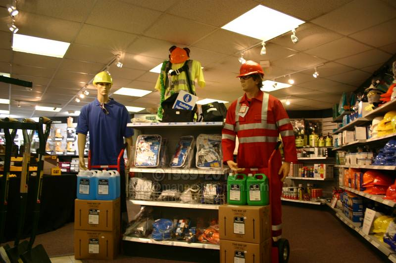 dressed as a rescue worker in a red hi-vis coverall, standing next to a real mannequin in a shop display - Living Mannequin Arco Event Day Watford