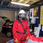 mannequin-man performming as a Living Mannequin: mannequin man set up display area wearing red overall, white hard hat and breathing apparatus for Arco on 24/05/2000