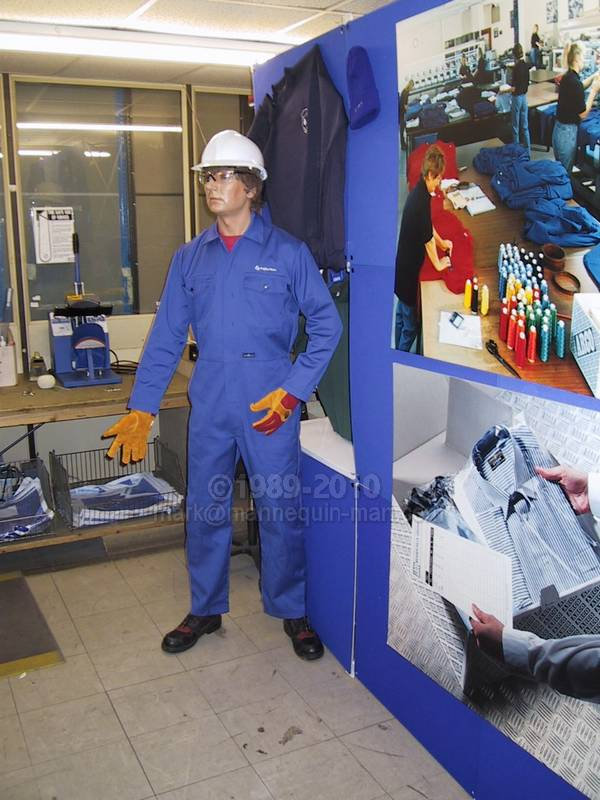 mannequin man set up in embroidery display area, wearing blue overall with embroidered name and white hard hat - Living Mannequin Open day in Shop Arco East Anglia, Bury St. Edmunds