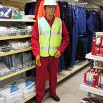 mannequin-man performming as a Living Mannequin: mannequin man set up in shop clothing display wearing red overall, yellow hi-vis jacket and white hard hat for Arco on 24/05/2000
