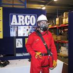 mannequin-man performming as a Living Mannequin: mannequin man set up display area wearing red overall white hard hat and BA (breathing apparatus) for Arco on 24/05/2000