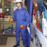 mannequin-man performming as a Living Mannequin: Mannequin man the human mannequin at an Arco Open DAy in Ipswich, set up in embroidery display area, wearing blue overall with embroidered name and white hard hat for Arco on 24/05/2000