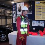 mannequin-man performming as a Living Mannequin: mannequin man set up display area wearing red overall, white hard hat and BA kit (breathing apparatus) for Arco on 24/05/2000
