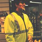 "mannequin-man performming as a Living Mannequin: mannequin man as display dummy in Arco shop in Orpington wearing green overall, hi-vis jacket and ""elvis"" wig for Arco on 22/12/1994"