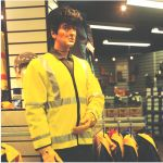 Mannequin man the human mannequin performing as a living safety dummy at the Arco shop in Orpington wearing Green overall and yellow hi-vis waistcoat