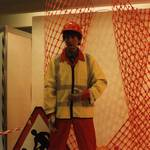 mannequin-man performming as a Living Mannequin: Living mannequin man in a safety display at the Arco Experience Doncaster, wearing a red overall, yellow hi-vis jacket and red hard hat for Arco on 21/09/1994