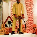 mannequin-man performming as a Living Mannequin: mannequin man on podium display using a pneumatic drill, wearing a yellow PVC hi-vis overall and red hard hat at the Arco Experience Doncaster for Arco on 21/09/1994