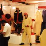 mannequin-man performming as a Living Mannequin: mannequin man on floor wearing a yellow PVC hi-vis overall and red hard hat at the Arco Experience Doncaster for Arco on 21/09/1994