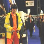 mannequin-man performming as a Living Mannequin: mannequin man on Arco stand at RoSPA wearing an orange overall for Arco on 21/05/1996