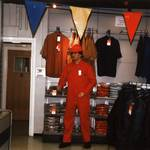 mannequin man set up in shop, wearing red overall and red hard hat at an Arco open day in Watford