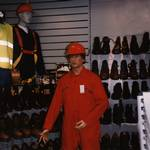 mannequin-man performming as a Living Mannequin: mannequin man set up in shop, wearing red overall and red hard hat at an Arco open day in Watford for Arco on 12/10/1996