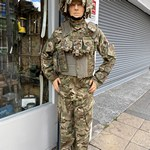Mannequin man performing at Eastman Camp army surplus and clothing store in Walthamstow Market