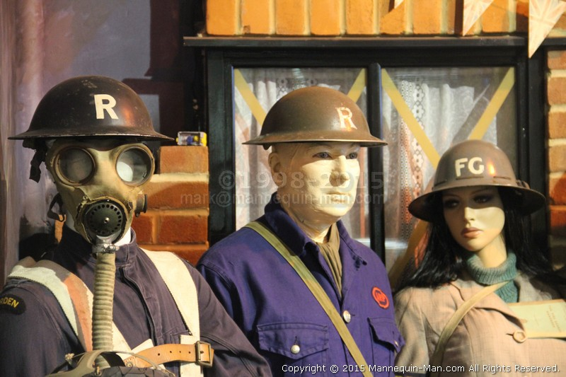 Taking the place of a mannequin wearing an ARP uniform from the second war during a Family Fun Day at the Essex Fire museum to the amusement of the visiting children - ARP Warden Uniform Exhibit At The Essex Fire Museum