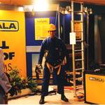 RoSPA 13th - mannequin man on BH-SALA (Now DBI Sala, part of Capital Safety) stand at RoSPA, wearing blue overall, yellow hard hat and yellow BH-SALA safety harness