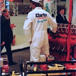 mannequin-man performming as a Living Mannequin: mannequin man on standing still as a living display dummy on the Clarke Power Tools stand at Hirex, wearing white Clarkes overall with white cap for Clarke International on 13/02/1991