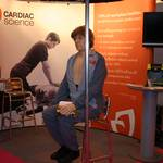 mannequin-man performming as a CPR Dummy: Mannequin-man in his role as danny CPR, the world's most lifelike cpr training dummy demoing a Defibrillator on the Cardiac Science Stand at the Education Show, NEC 2010 for Cardiac Science on 06/03/2010