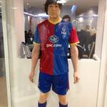 mannequin-man performming as a Living Mannequin: Hired to stand in the reception display cabinet taking the place of the mannequin, wearing Crystal Palace football kit  for Crystal Palace Football Club on 22/02/2014