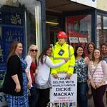mannequin-man performming as a Living Mannequin: Dickie the mannequin outside the shop with a group of ladies having a selfie taken for Mackays on 23/08/2014
