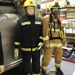 mannequin-man performming as a Museum Dummy: The mannequins in this scene are wearing uniforms worn by firemen between (from left to right) 1941-1948, 1970's, 1970s-1989 and the Present day for Essex Fire Museum on 16/02/2016