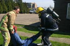 mannequin-man performming as a drag dummy: Being used by Event Fire, who have fire fighter training days, acting as a casualty with other drag dummies in smoke filled building, waiting to be rescued by team wearing BA equipment for Event Fire & Rescue on 02/04/2005