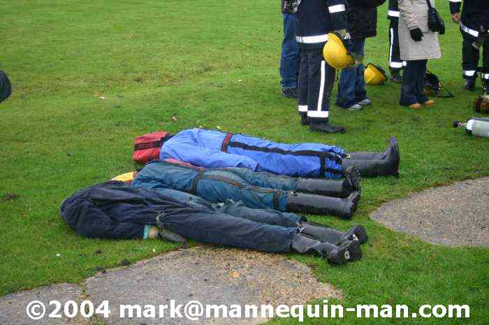 mannequin lying with other ruthlee drag dummies after having been removed from smoke filled building - drag dummy Event Fire & Rescue Redhill Aerodrome