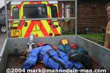 mannequin-man performming as a drag dummy: mannequin lying with another ruthlee drag dummy on a trailer after use for Event Fire & Rescue on 20/11/2004