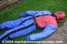mannequin-man performming as a drag dummy: mannequin lying on grass after having been removed from smoke filled building for Event Fire & Rescue on 20/11/2004