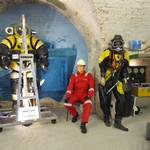 mannequin-man performming as a Museum Dummy: as Subsea 7 diver next to Newt Suit for The Diving Museum on 25/05/2015