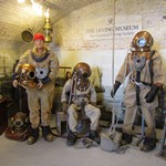 3 mannequins Exhibits dressed in canvas diving suits and hard helmets at the Diving Museum Gosport