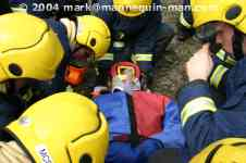 mannequin-man performming as a drag dummy: The casualty's condition is checked again for West Mids Fire Service on 10/05/2004