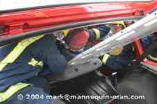 mannequin-man performming as a drag dummy: A spine board is positioned under the casualty for West Mids Fire Service on 10/05/2004