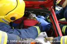 mannequin-man performming as a drag dummy: The casualty is gently manoeuvred onto the spine board for West Mids Fire Service on 10/05/2004