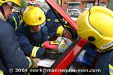 mannequin-man performming as a drag dummy: The casualty is extricated from the rear of the vehicle for West Mids Fire Service on 10/05/2004