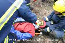 mannequin-man performming as a drag dummy: The casualty is moved to a safe location on the spine board for West Mids Fire Service on 10/05/2004