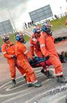 mannequin-man performming as a drag dummy: The UKFS SAR team carry the 'live' maniken casualty during the EAZ demonstration at the International Fire Expo 2005.  for Firex (CMP Information) on 17/05/2005