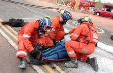 mannequin-man performming as a drag dummy: The UKFS SAR team put the 'live' drill drag dummy casualty down in front of the audience during the EAZ demonstration at the International Fire Expo 2005.  for Firex (CMP Information) on 17/05/2005