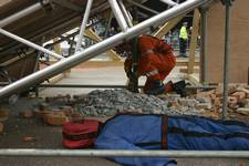 mannequin-man performming as a drag dummy: Mannequin-man, acting as a 'live' drill drag dummy casualty, in place and waiting to be rescued at during the EAZ demonstration at the International Fire Expo 2005.  for Firex (CMP Information) on 17/05/2005