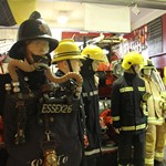 mannequin-man performming as a Museum Dummy: Taking the place of a mannequin wearing a 1970s fireman's uniform during a Family Fun Day at the Essex Fire museum to the amusement of the visiting children for Essex Fire Museum on 13/08/2015