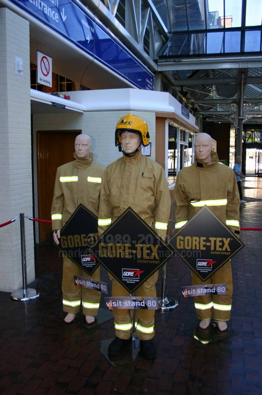Three Display Mannequins in foyer of Fire 2004, dressed in gore-tex fire turnout kit, one a bit more real than the others - Living Mannequin with two real mannequin on Foyer of Fire 2004 NEC