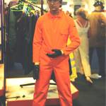 mannequin-man performming as a Living Mannequin: mannequin man on Greenham Trading stand at RoSPA wearing orange overall, yellow hard hat for Greenham Trading on 20/06/1995