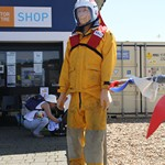 mannequin-man performming as a Living Mannequin: Famous in Hastings, there are two mannequins that stand outside collecting donations for the RNLI, during the armed forces day celebrations, one of the mannequins was real.