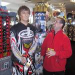 Living Mannequin at a Hein Gericke Shop Promotion wearing Motor Cross Gear with customer