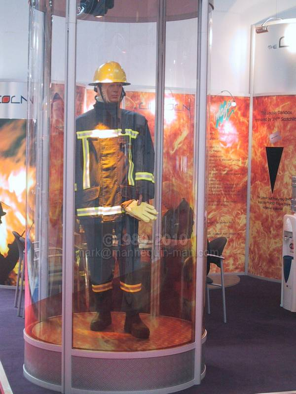 mannequin man the human mannequin, dressed in fire turnout gear in Lincoln Stand - Living Mannequin Safety & Health Expo NEC